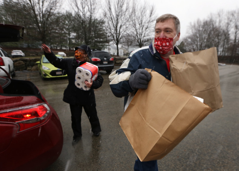 O & O's For A Cause holds a food drive outside of Owen & Ollie's restaurant, with donations going to the Dracut Food Pantry. Bill Lafferty of Lowell, a board member of O & O's For A Cause, and Mary Kay Gorman, treasurer, unload donations. (SUN/Julia Malakie)
