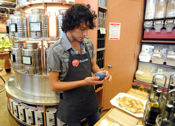"""Amedeo Negrini of Alfalfa's, savors  one of his favorite  olive oils.<br /> For a video of olive oil tasting, go to  <a href=""""http://www.dailycamera.com"""">http://www.dailycamera.com</a>.<br /> Cliff Grassmick / July 1, 2011"""