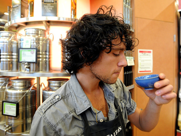 "Amedeo Negrini of Alfalfa's, tastes one of his favorite  olive oils.<br /> For a video of olive oil tasting, go to  <a href=""http://www.dailycamera.com"">http://www.dailycamera.com</a>.<br /> Cliff Grassmick / July 1, 2011"