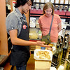 "Amedeo Negrini of Alfalfa's, offers Martha Limber a taste of one of the olive oils.<br /> For a video of olive oil tasting, go to  <a href=""http://www.dailycamera.com"">http://www.dailycamera.com</a>.<br /> Cliff Grassmick / July 1, 2011"