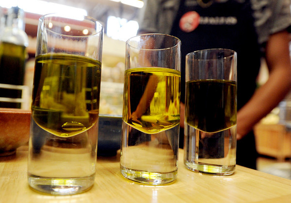 "Examples of some of the oils offered at Alfalfa's.<br /> For a video of olive oil tasting, go to  <a href=""http://www.dailycamera.com"">http://www.dailycamera.com</a>.<br /> Cliff Grassmick / July 1, 2011"