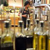 "Amedeo Negrini of Alfalfa's, sets up labels on the olive oil display.<br /> For a video of olive oil tasting, go to  <a href=""http://www.dailycamera.com"">http://www.dailycamera.com</a>.<br /> Cliff Grassmick / July 1, 2011"