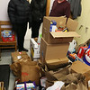 From left, Lowell Democratic City Committee chair Judith Durant and Ward 2 chair Sally Coulter, both of Lowell, with Open Pantry executive director Geoff Bryant and some of the about 500 lbs of food donated on behalf of the Lowell Democratic City Committee, along with monetary contributions.  (SUN/Julia Malakie)