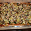 Pizza - Onions, spinach, artichoke hearts, pineapple, mushrooms, Parmesan cheese over home made dough.