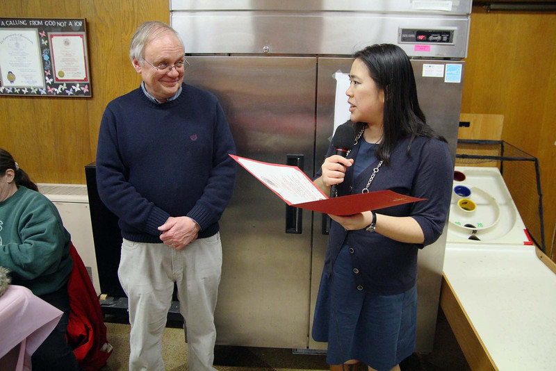 David Sciabarrasi the treasurer for Our Father's Table listens to Mayor Lisa Wong as she gave them a citation for 31 years of serve on Tuesday night in Fitchburg. SENTINEL & ENTERPRISE/JOHN LOVE