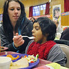 Enjoying the great food at the 31st anniversary dinner for Our Father's Table on Tuesday night in Fitchburg Adriana McLeod and her daughter Brooklyn Rosario, 5. SENTINEL & ENTERPRISE/JOHN LOVE