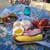 Outdoor dining at the Sunset Tiki Bar at Nashoba Valley Ski Area in Westford. Burger and lobster dishes at the Sunset Tiki Bar. (SUN/Julia Malakie)