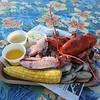 Outdoor dining at the Sunset Tiki Bar at Nashoba Valley Ski Area in Westford. Lobster at Sunset Tiki Bar. (SUN/Julia Malakie)
