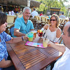 Outdoor dining at the Sunset Tiki Bar at Nashoba Valley Ski Area in Westford. From left, Stacey Flaherty of Westford, David Lemieux and his wife Darlene Lemieux of Dracut, and Flaherty's brother Michael Flaherty of Littleton. They all grew up together in Littleton. (SUN/Julia Malakie)