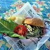 Outdoor dining at the Sunset Tiki Bar at Nashoba Valley Ski Area in Westford. Burger at Sunset Tiki Bar. (SUN/Julia Malakie)