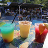 Outdoor dining at the Sunset Tiki Bar at Nashoba Valley Ski Area in Westford. Drinks, from left: Malibu Sandbar, Painkiller (with nutmeg on top), and Homemade Sangria. (SUN/Julia Malakie)