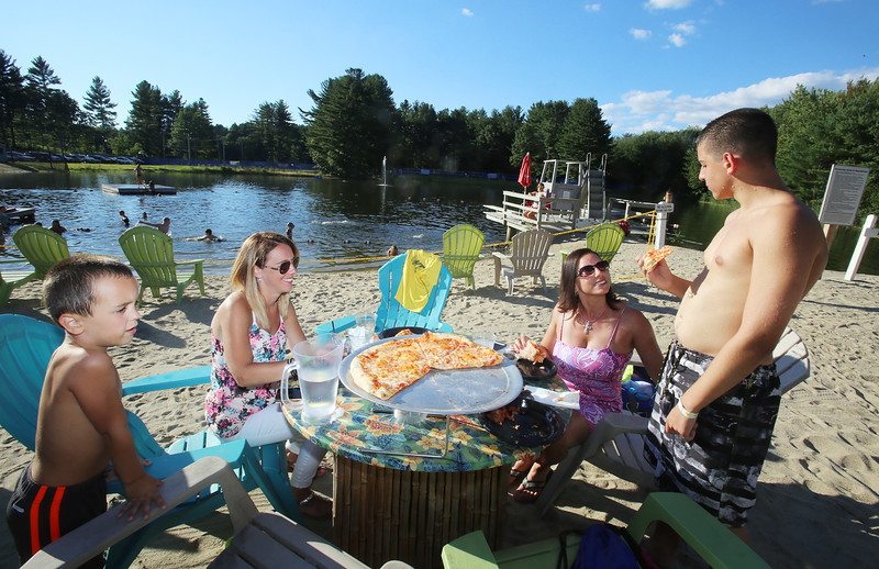 Outdoor dining at the Sunset Tiki Bar at Nashoba Valley Ski Area in Westford. From left, Patrick Taylor, 5, and his mother Vicki Travers of Wilmimington and friends Michelle Cincotti of Billerica and her son Jake Bray, 14. (SUN/Julia Malakie)