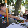 Outdoor dining at the Gallery Cafe at 529 King Street in Littleton. From left, Chloe Greenslade, 12, and her cousins Jaden Greenlade, 10, rear, and Kenny Greenslade, 9, all of Westford, eating the House Special Salad. (SUN/Julia Malakie)