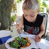 Outdoor dining at the Gallery Cafe at 529 King Street in Littleton. Kenny Greenslade, 9, of Westford, eats a House Special Salad. (SUN/Julia Malakie)