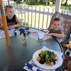 Outdoor dining at the Gallery Cafe at 529 King Street in Littleton. Kenny Greenslade, 9, and his brother Mason, 4, with their dog Riley. (SUN/Julia Malakie)