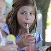 Outdoor dining at the Gallery Cafe at 529 King Street in Littleton. Jaden Greenslade, 10, of Westford, sips a strawberry-basil lemonade. (SUN/Julia Malakie)
