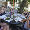 Outdoor dining at the Gallery Cafe at 529 King Street in Littleton. From left, Liz Greenslade, with her niece Chloe Greenslade, 12, daughter Jaden, 10, hidden, and sons Kenny, 9, and Mason, 4, eating a fried goat cheese ball from the House Special Salad. All are of Westford. (SUN/Julia Malakie)