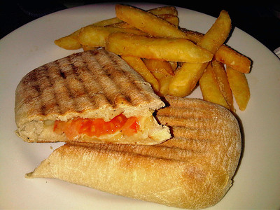 "Mature Cheddar cheese and tomato panini & chips. £5.10. Served in ""Weatherspoons""  06/03/12"