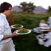 Student Levi Lujan, rushes to the table with two of the courses.<br /> Students from the Culinary School of the Rockies spend 10 days in Paonia, Colo. and the surrounding area learning where food comes from.<br /> <br /> <br /> Cliff Grassmick/ September 16, 2008