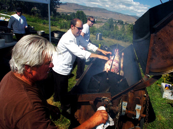Chef Yvon Gros, bottom, Shef Adam Dulye and student Karl Kriegh, monitor the roasting of the lambs.<br /> Students from the Culinary School of the Rockies spend 10 days in Paonia, Colo. and the surrounding area learning where food comes from.<br /> <br /> <br /> Cliff Grassmick/ September 16, 2008