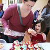 """Lawrence Library in Pepperell holds its fifth annual Cupcake Festival fundraiser. Molly Wiatr, 4, and her mother Siobhan Wiatr of Pepperell pick out a """"pink gummies on the ocean"""" cupcake for their tray of six. (SUN/Julia Malakie)"""