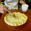 Shamane Simons brushes the pie with egg wash. <br /> KASIA BROUSSALIAN / THE CAMERA