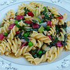 "<h1>Spring Vegetable Pasta</h1> This is a wonderful, fresh version of a pasta primavera recipe from the May/June 2011 issue of Cooks Illustrated.  They took the best part of pasta primavera --- the young, lightly sauted spring vegetables and did away with the heavy, stodgy cream sauce that totally overwhelms these luscious vegetables.  They replaced that sauce with a wine and broth infused sauce in which the pasta cooks in the manner that one cooks risotto .... browning the raw pasta in hot oil, adding in wine, and then cooking the pasta till al dente in a rich vegetable broth.  The result is a wonderfully flavorful dish, where the veggies' flavors really shine.  The original recipe used asparagus, leeks, and baby peas for the veggies, and mint and chives for the herbs.  Not liking either asparagus or mint (~~collective gasp~~), I used red chard (chopping the crispy stems and using them for their crunch and then quickly stir-frying the slivered green portion).  Instead of mint, I used fresh basil along with lemon zest and a splash of lemon juice.  Recipe at <b><a href=""http://www.cooksillustrated.com/recipes/detail.asp?docid=27843"" rel=""nofollow"">Cook's Illustrated</a></b>.   This requires a paid membership, but they offer a 14 day free trial which will give access to the wealth of info on their website, including this recipe.  Even though it is not a vegan or even a vegetarian magazine, I've subscribed to Cook's Illustrated for over 10 years and find every issue super useful and loaded with useful techniques.   Many of their recipes are easily veganized.  The only non-vegan ingredient in this dish is parmesan cheese; I used <b><a href=""http://www.galaxyfoods.com/galaxy-products/vegan-cheese/vegan/vegan-topping/"" rel=""nofollow"">Galaxy Food's Vegan Parmesan</a></b>."