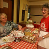 Polish Food Festival at Holy Trinity Polish Church. Carol Wolosewicz, left, and Florence Desmarais, both of Lowell, at the dessert table. (SUN/Julia Malakie)