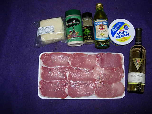 ingredients for pork roll-ups: you will need bonless pork loin, swiss cheese, parmesan cheese(grated),dry oregano leaves, garlic, capers,a dry white wine, sour cream, salt and pepper.  An onion and some mushrooms are optional.