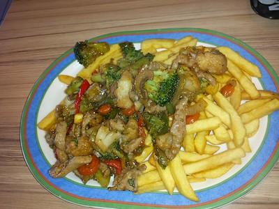 Supertje Varkensvlees - Prk & Vegetables on a bed on chips. €6.80.  Served in Cafetaria Dorst in Dorst, Holland  28/04/15
