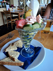 "Knickerbocker Prawns - peeled prawns served in the dessert glass with mixed leaves and smooth seafood sauce, served with granary bread. £6.95.  Served in ""The Babbacombe Inn"" in Torquay  05/07/14"