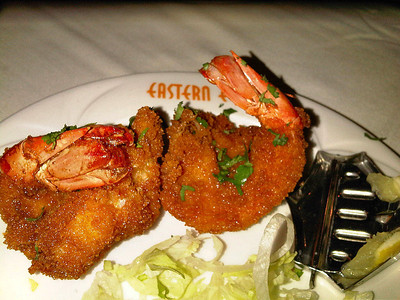 "Battered king prawn coated with breadcrumbs & deep fried. £4.82. Served in ""Eastern Eye"" in Newton Abbot. 29/11/11"