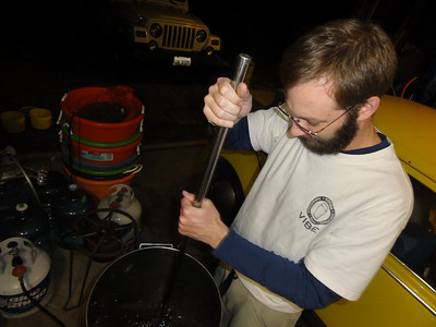 Here is Eric stirring it up. We have added one gallon of water to twenty-four pounds of honey to the brew pot. Once this mixture has been stired in and is almost to boil we add in the puree from the Rubbermaid cooler.