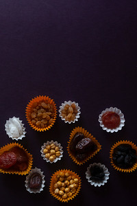 Eid Mubarak. Different iftar sweets. Celebrating Eid Al Adha. Islamic traditional holiday. Eid al-Fitr. Holly month Ramadan. Middle Eastern religious holiday. Dried date fruit. Flat lay, top view.