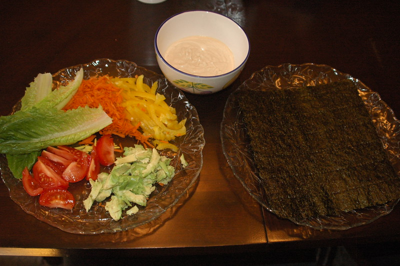 Nori Wraps.  I tried the plain nori, but honestly, I prefer the toasted.  Still, I'll count it as a raw food meal since everything else was raw, even the cashew sauce.  Inside, I put yellow bell peppers, shredded carrots, tomatoes, avocado and romaine.