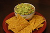 Guac with homemade corn chips.