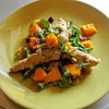 Mauby-marinated chicken salad with mangos, plantains and purslane