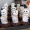 """Made these for the party at school. The idea is from this site <br /> <a href=""""http://wantsandwishesdesign.blogspot.com/2011/10/eek-shriek-and-be-scary-halloween.html"""">http://wantsandwishesdesign.blogspot.com/2011/10/eek-shriek-and-be-scary-halloween.html</a><br />  I used cupcakes instead of brownies.  I used edible markers to draw the faces."""