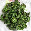 Kale Chips<br /> <br />  This was soooo good! And it's good for you. Cheap too. One bunch is less than a buck! I ended up making two batches in one day. They come out crispy and full of flavor. Yummy!  The kids go crazy for these!<br /> <br />  1 bunch of kale<br /> <br />  1 tbsp olive oil<br /> <br />  kosher salt to taste<br /> <br />  Directions<br />  1.Preheat an oven to 350 degrees F (175 degrees C). Line a non insulated cookie sheet with parchment paper.<br />  2.With a knife or kitchen shears carefully remove the leaves from the thick stems and tear into bite size pieces. Wash and thoroughly dry kale with a salad spinner. Drizzle kale with olive oil and sprinkle with seasoning salt.<br />  3.Bake until the edges brown but are not burnt, 10 to 15 minutes.