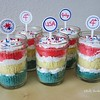 Happy 4th of July!<br /> I made a box cake mix (white) and divided the mix into 3 bowls.  I used food coloring to make one bowl red, one blue and left the last white.  Pour into cupcake wrappers/tins and baked as directed.  I let them cool and cut them in half layering them in the jars with buttercream frosting.  Made the little decorations.  These didn't last long.  They were gone shortly after this.  I was lucky to get a picture.