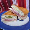 Cuban Midnight Sandwich<br />  5 stars. Delicious! I'll be making this one again. <br /> <br />  Ingredients<br />  1 cup mayonnaise<br />  5 tablespoons Italian dressing<br />  4 hoagie rolls, split lengthwise<br />  4 tablespoons prepared mustard<br />  1/2 pound thinly sliced deli turkey meat<br />  1/2 pound thinly sliced cooked ham<br />  1/2 pound thinly sliced Swiss cheese<br />  1 cup dill pickle slices<br />  1/2 cup olive oil<br /> <br /> <br /> <br /> <br />  Directions<br />  1. In a small bowl, mix together mayonnaise and Italian dressing. Spread mixture on hoagie rolls. Spread each roll with mustard. On each roll, arrange layers of turkey, ham, and cheese. Top each with dill pickle slices. Close sandwiches, and brush tops and bottoms with olive oil. <br />  2. Heat a non-stick skillet over medium high heat. Place sandwiches in skillet. Cook sandwiches for 2 minutes, pressing down with a plate covered with aluminum foil. Flip, and cook for 2 more minutes, or until cheese is melted. Remove from heat, place on plates, and cut in half diagonally.<br /> -allrecipes by Maruchy Ramos-Lachance