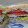 Tilapia Po'Boy<br /> We loved these and will be making them again! They were a hit with the kids too. <br /> 1 large egg<br /> 1/3 cup seasoned breadcrumbs<br /> 4 four oz tilapia fillets<br /> 1/3 cup mayo<br /> 1 small chipotle chile in adobo sauce, plus a tsp of sauce (we left the chile out and just used the sauce, it's really hot!) This comes in a can and can be found in the Hispanic/latino section of the grocery store.<br /> 1 soft baguette, we used ciabata rolls<br /> 4 leaves of lettuce, we used romaine<br /> 2-large tomatoes, sliced<br /> 1 tbsp oil<br /> In a shallow bowl beat the egg.  Spread the breadcrumbs in a dish.  Season fish with salt and pepper.  Dip the fish in the egg, then the breadcrumbs, coating completely.<br /> In a small bowl mix mayo and chipotle sauce.  Spread sauce on split side of bread.  <br /> Heat oil to medium high heat, cook fish about 3 minutes on each side.  <br /> Place fish lettuce and tomatoes on bread and serve.<br /> -Rachael Ray Mag