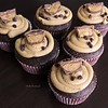 Triple Chocolate Peanut Butter Cupcakes<br />  Melt in your mouth yum! The best part, there's a mini peanut butter cup inside every cupcake!<br />  Peanut Butter Frosting<br />  1 1/2 cups peanut butter<br />  1/4 tsp vanilla<br />  4 tbsp butter<br />  1-2 cups powdered sugar<br />  Mix peanut butter, vanilla, and butter until well blended. Slowly add powdered sugar until you get the right texture and flavor. For me 1 1/2 cups of powdered sugar was just right.<br />  Triple Chocolate Cupcakes<br />  I used Betty Crocker triple chocolate cake mix and added a mini peanut butter cup in the middle of each cupcake before baking. Bake as directed, let cool and frost with peanut butter frosting. Top with mini chocolate chips and half of a peanut butter cup.