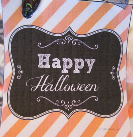 """Added some fun halloween tags that I printed, glued onto card stock and cut out. They are from this site.<br /> <a href=""""http://www.thecreativityexchange.com/2012/10/free-printable-halloween-tags-labels-printable-of-the-month.html"""">http://www.thecreativityexchange.com/2012/10/free-printable-halloween-tags-labels-printable-of-the-month.html</a>"""