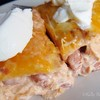 Easy Chicken Enchiladas<br />  This one was great. It was also super easy! Great weeknight meal! <br />  2 (8 ounce) packagescream cheese<br />  2 cups salsa<br />  4 cups chopped cooked chicken breast meat<br />  2 (15.5 ounce) cans pinto beans, drained<br />  12 (6 inch)flour tortillas<br />  4 cups shredded Colby-Jack cheese<br /> <br />  Directions<br /> <br />  Preheat the oven to 350 degrees F (175 degrees C). Lightly grease a 9x13 inch baking dish.<br />  In a small saucepan over medium heat, combine the cream cheese and salsa. Cook, stirring until melted and well blended. Stir in chicken and pinto beans. Fill tortillas with the mixture, roll and place into the prepared baking dish. Spread cheese over the top. Cover with aluminum foil.<br />  Bake for 30 minutes, or until heated through. Garnish with your favorite toppings such as lettuce and tomatoes, or sour cream.<br /> -allrecipes by Iankris