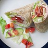 Turkey Wraps<br />  Fantastic! We all loved them and I'll be making these again.<br />  Ingredients<br />  1 (8 ounce) package cream cheese with chives<br />  2 tablespoons Dijon mustard<br />  6 (8 inch) whole wheat tortillas<br />  1 1/2 cups finely shredded iceberg lettuce<br />  12 slices thinly sliced deli turkey<br />  3/4 cup shredded Swiss cheese<br />  1 large tomato, seeded and diced<br />  1 large avocado, sliced<br />  6 slices bacon, cooked and crumbled<br /> <br /> <br /> <br /> <br />  Directions<br />  1. Mix together the cream cheese and Dijon mustard until smooth. Spread each tortilla with about 2 tablespoons of the cream cheese mixture, spreading to within 1/4 inch of the edge of the tortillas. <br />  2. Arrange about 1/4 cup of shredded lettuce on each tortilla, and press the lettuce down into the cream cheese mixture. Place 2 turkey slices per tortilla over the lettuce, and sprinkle with 2 tablespoons of shredded Swiss cheese. Top each tortilla evenly with tomato, avocado slices, and crumbled bacon. <br />  3. Roll each tortilla up tightly, and cut in half across the middle with a slightly diagonal cut.<br /> -allrecipes by Rochelle T