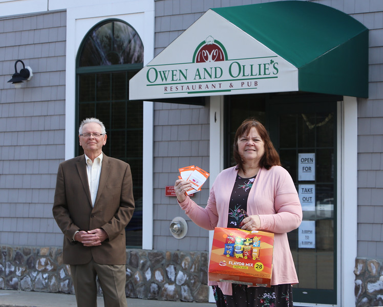 Harry Gorman of Dracut, owner of Owen & Ollie's restaurant, and State Rep. Colleen Garry of Dracut. Gorman is donating an amount equal to 10% of restaurant gift card sales in April to the Lavender Cart fund to buy snacks for Lowell General Hospital workers. (SUN/Julia Malakie)
