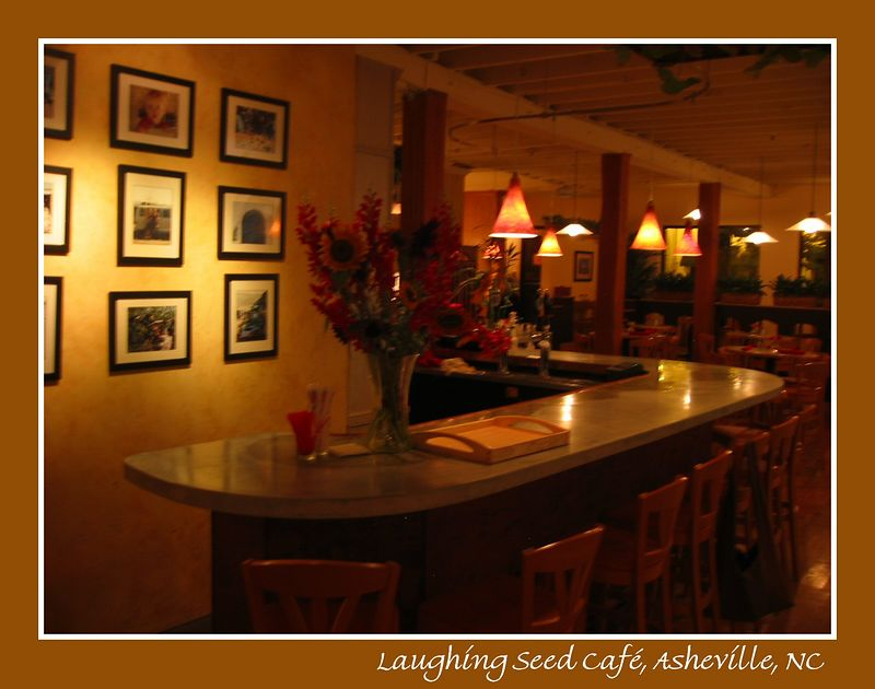 Low-lit bar area with flowers [borders, text]