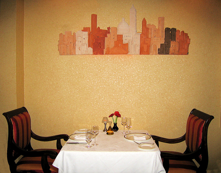 Il Palio Restaurant, Chapel Hill - table beneath cityscape sculpture