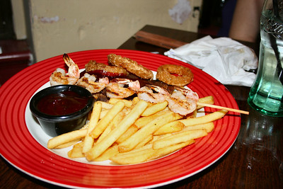 "Ribs & Shrimp Combo - Baby back pork ribs marinated for 14 hours and flame-grilled. Served with Cajun-battered onion rings and crispy fries with Cajun-spiced shrimp skewer. £12.49. Served in ""TGI Fridays""  15/12/11"